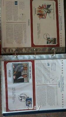 UNITED WE STAND INTERNATIONAL 52 FIRST DAY COVERS With ALBUM SEPT. 11 911 TRIBUTE